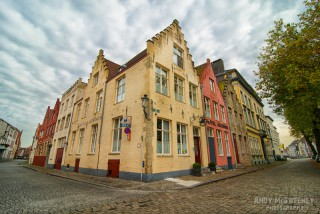 Corner shot of Hotel Adornes with clouds and cobblestones in Brugge, Belgium