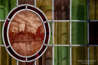 Colorful Venetian glass on a house window in Brugge, Belgium