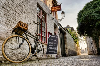 Café Vlissinghe with sign, lamp and classy bike, the oldest café in Brugge, Belgium