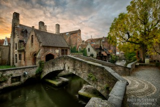 The smallest bridge in Brugge, Belgium with surrounding houses and parc