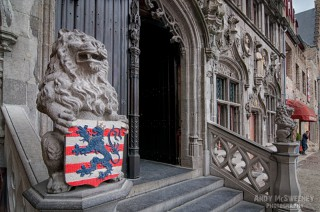 The two lions and their plaque in front of the Basilica of the Holy Blood in Brugge, Belgium