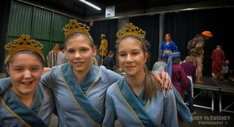 Three girls in costume posing for the camera during the rehearsal of the Holy Blood Procession in Brugge, Belgium 2015