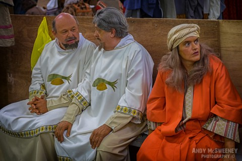 A candid shot of three colorful figurants at the rehearsal of the Holy Blood Procession in Brugge, Belgium 2015