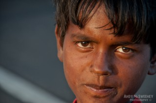Close-up portrait of an Indian beggar boy on the streets of South-India
