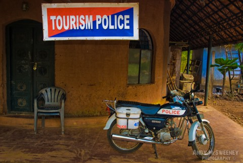 "Colorful ""Tourism Police"" sign at the police station in India with motorbike in the front."