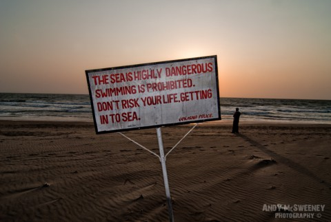 "Beach police sign in India, Gokarna saying ""Don't Risk Your Life Getting In To Sea"""
