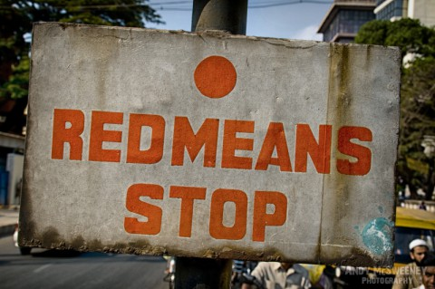 "Street sign in India saying ""Red Means Stop""."
