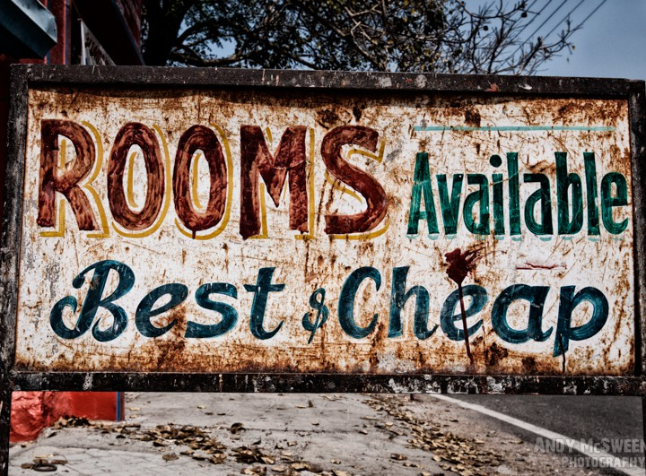 "Old colorful street sign in India saying ""Rooms Available, Best & Cheap"""