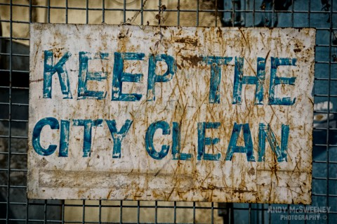 "Old colorful street sign in India saying ""Keep The City Clean"""