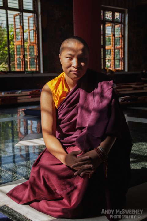 Colorful portrait of Sherab, a female monk in the monastery of Bylakuppe, South-India