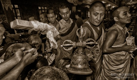 Black and white portrait of monks giving out blessings during a puja ceremony in the monastery of Bylakuppe, South-India