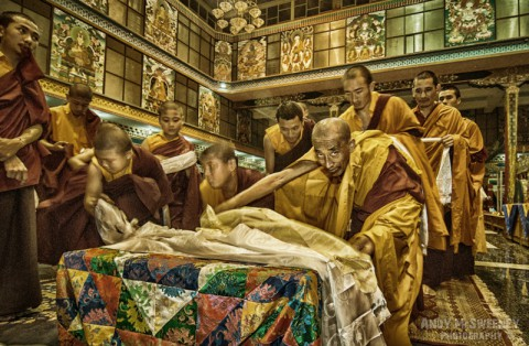 Colorful portrait of praying monks with kata during the funeral ceremony of His Holiness Penor Rinpoche in the monastery of Bylakuppe, South-India