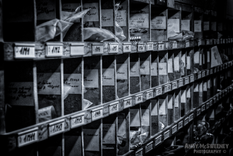 Black and white photo of an old filing compartment in a closed cotton UCO factory in Brugge, Belgium.