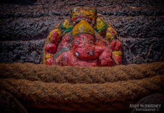 A colorful Ganesh surrounded by rope in South-India
