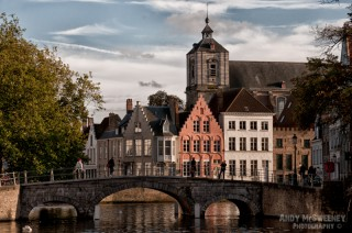 The Carmersbrug with people, gable houses and church in Brugge, Belgium