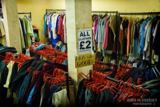 Racks of cheap clothes in a secondhand shop in London, United Kingdom
