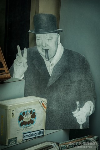 Photo of a paper cut out of Winston Churchill with cigar giving the peace sign in London, United Kingdom