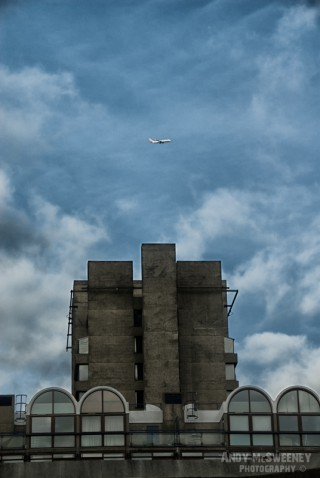 Plain flies over industrial building in London, United Kingdom