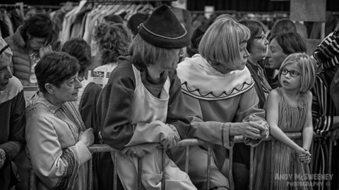 A black and white photo of figurants waiting their turn at the at the rehearsal of the Holy Blood Procession in Brugge, Belgium 2015