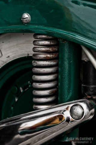 A close-up of the suspension on a Vespa scooter during Mod Days Brugge, Belgium