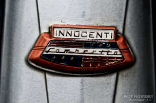 Detail shot of an Innocenti Lambretta sign on a vintage scooter during Mod Days Brugge, Belgium
