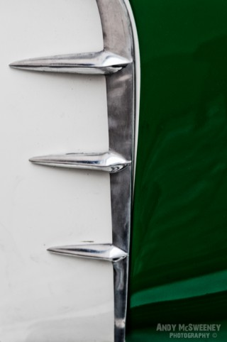 Detail shot of chrome and green on a vintage Vespa scooter during Mod Days Brugge, Belgium