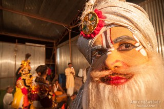 Colorful close-up portrait of an Indian performer with turban and make-up during a ceremony in South-India