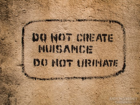 "Wall sign in India saying ""Do Not Cause Nuisance, Do Not Urinate"""