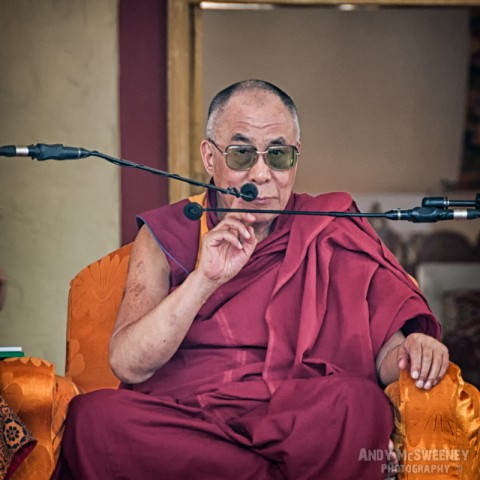 His Holiness the Dalai Lama taping his microphone at a public speech in the monastery of Bylakuppe, South-India